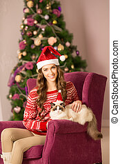 Christmas party, winter holidays woman with cat. New year...