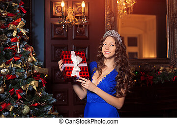 Christmas party, winter holidays woman with gift box. New...