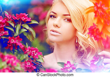 Young spring fashion woman. Trendy girl in the flowering...