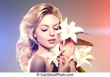 Beauty face woman, flowers, lily Girl healthy model in spa...