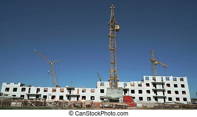 Construction site include four construction cranes -...