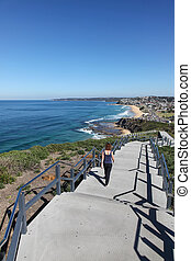 Newcastle Coastal Walkway - A woman walks along the a newly...