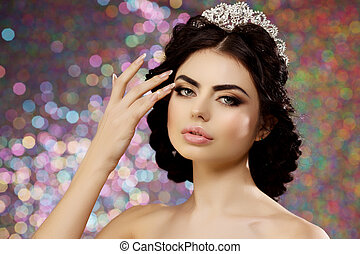 Woman in lux dress crown, queen princess lights party background