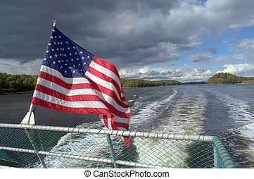 Waving American Flag blowing in the breeze from a boat....