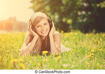 Beautiful smiling woman Woman listening to music on...