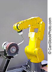 Robot - Yellow robotic arm for automatic operations in...