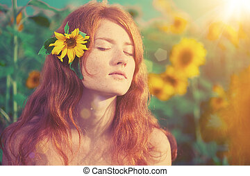 Red-haired woman with sunflowers - Beautiful red-haired...