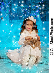 Christmas child girl on winter tree background, snow,...