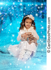 Christmas child girl on winter tree background, snow, snowflakes border