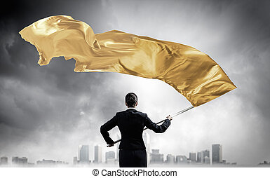 Woman waving yellow flag . Mixed media - Determined...