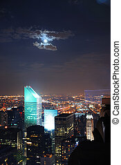 NEW YORK CITY NIGHT SCENES - Aerial view of New York City at...