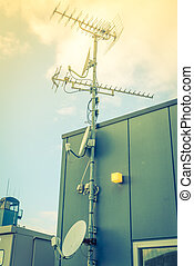 Satellite Dish and Antenna TV . ( Filtered image processed...