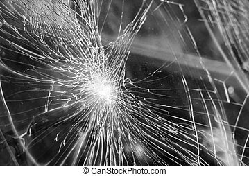 Glass broken cracks splinters in front of car - Glass broken...