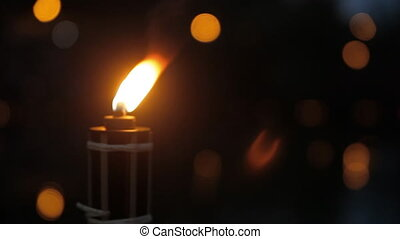 A small torch is burning in the night - A small light from a...