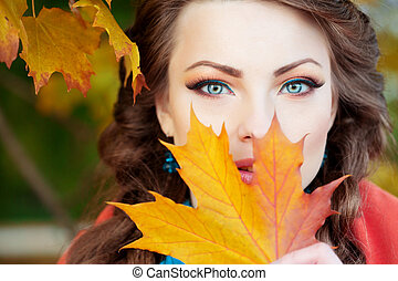 Autumn model, bright make up. woman on background fall...