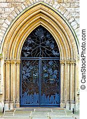 Ironwork door - Old church entrance door with iron ornaments...