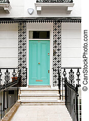Ironwork house - Blue entrance door on Victorian style house...