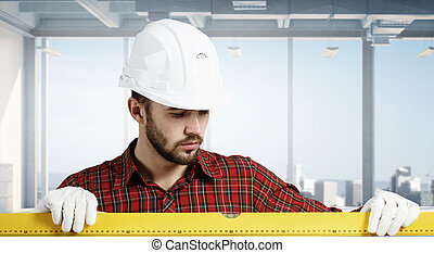 Young engineer man Mixed media - Builder man in checked...