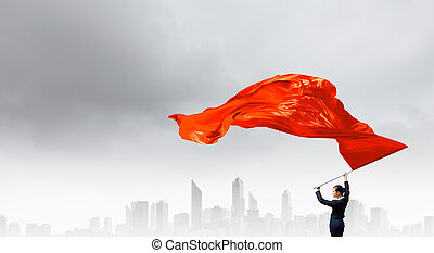 Woman waving red flag - Determined businesswoman waving flag...
