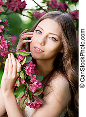 Young spring fashion woman in spring garden Springtime...