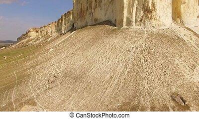 Famous White Rock Ak Kaya - AERIAL VIEW. Upward pan shot of...