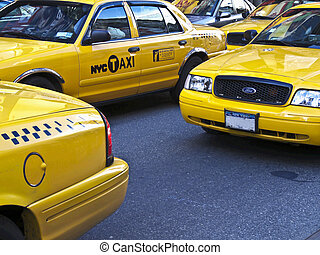 NYC Taxis - lots of yellow New York Taxis waiting on traffic...