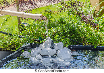 Japanese garden with bamboo fountain - Traditional bamboo...