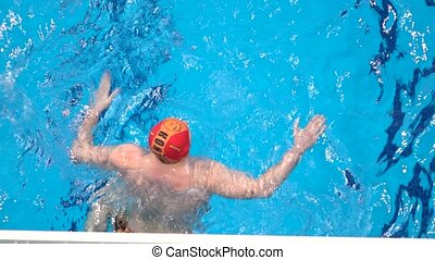 Unrecognizable water polo goalkeeper, view from above, zoom...