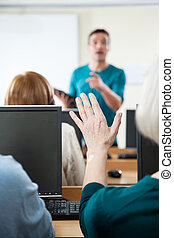 Senior Woman Asking Question In Computer Class - Senior...