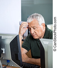 Depressed Senior Student Looking At Computer