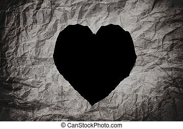 Heart shape, on crumpled paper texture background, abstract...