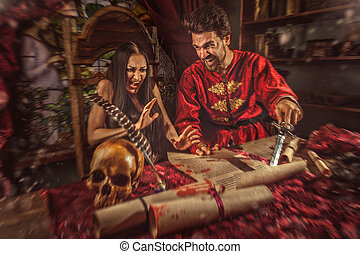 Medieval inquisitor is tempting witch to sign the...