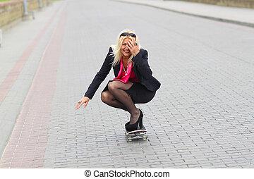 Senior business woman having fun on a skateboard outdoors. adult woman on a skateboard. business woman on a skateboard