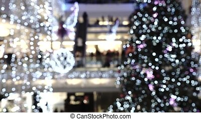 Christmas and New Year decorated shopping mall. Slow motion video
