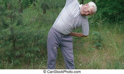 Old man does morning body incline with up hand in full HD