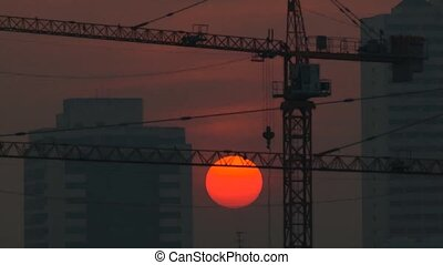 Sunshine morning time and crane with building construction...