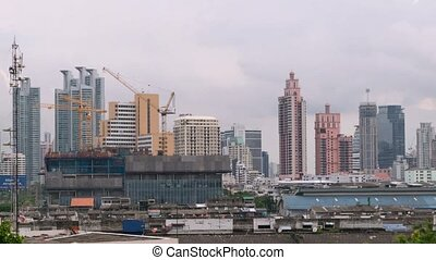 Daytime and crane with building construction in Bangkok city...