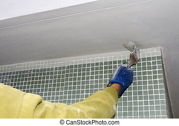 coating of a cornice in a construction site