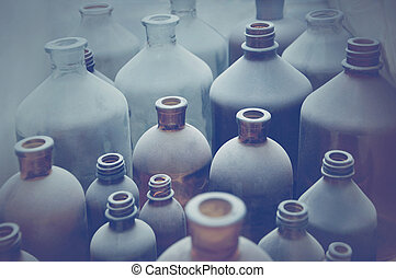 antique  bottles covered with dust