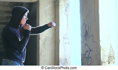 Kickboxer shadow boxing as exercise for the big fight in catacomb. Slowly