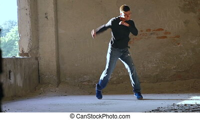 Kickboxer shadow boxing as exercise for the big fight in catacomb. Slow motion