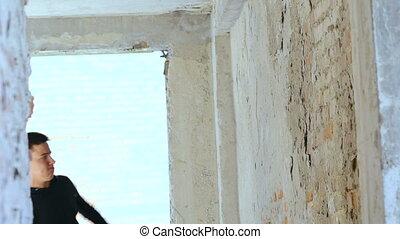 A sportsman back flips off a wall Slowly
