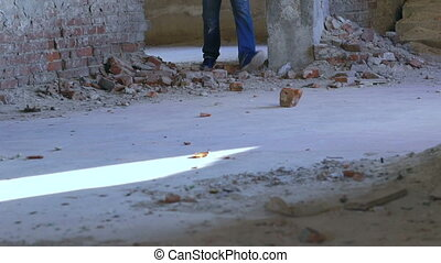 A man takes a brick fragment and throw it through the...