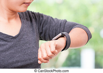 woman looking at her smart watch