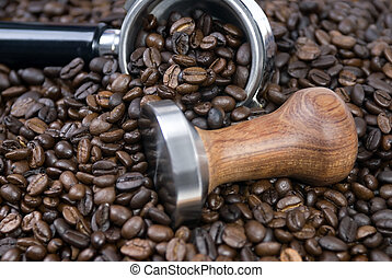 Coffee Time 2 - Roasted Coffee beans surround a tamper and...