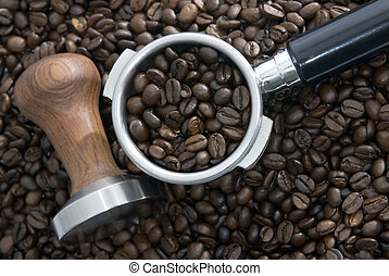 Coffee time - Roasted beans surround a tamper and filterits...