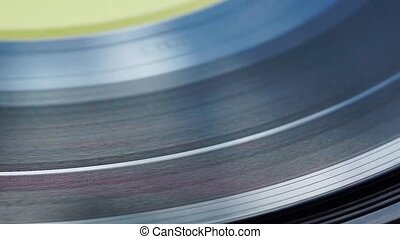Retro vinyl on electrophone - Retro vinyl record spinning on...