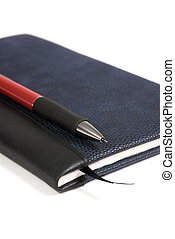 Diary and Pen 2 - A blue leather bound diary on a white...