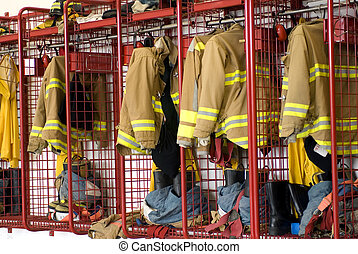 Firehouse locker - Fireman coats and boots wait for the next...