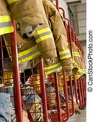 Fireman Coats 2 - A line of fireman coats await the next...